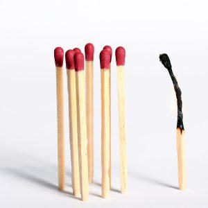 Burnout: abgebranntes Streichholz
