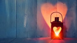 St Valentine's day greeting card with candle and hearts