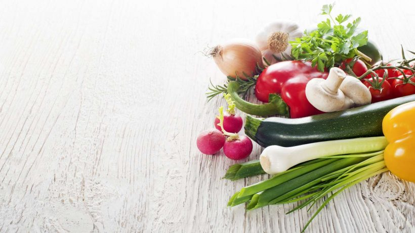 Vegetables on white wooden background close up